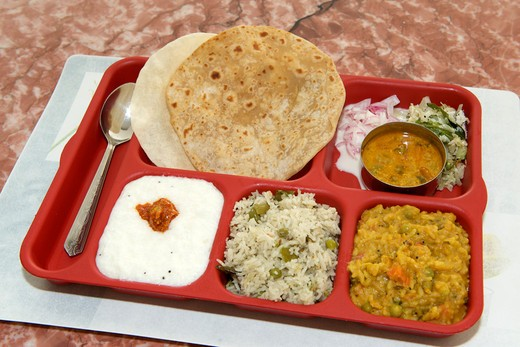 Vegetarian south Indian thali with rice, curd rice, sambar rice vegetable pulao and chapatti : Stock Photo