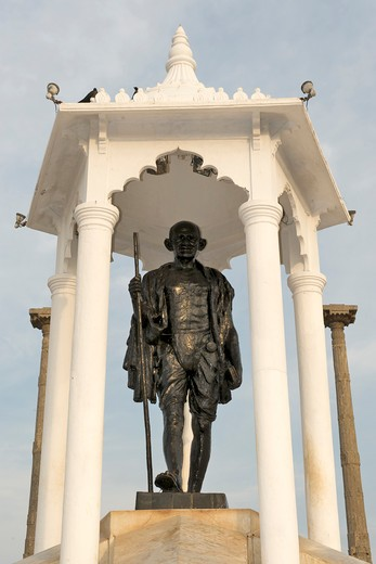 Low angle view of a statue of Mahatma Gandhi, Mahatma Gandhi's Monument, Goubert Avenue, Beach Road, Pondicherry, Tamil Nadu, India : Stock Photo