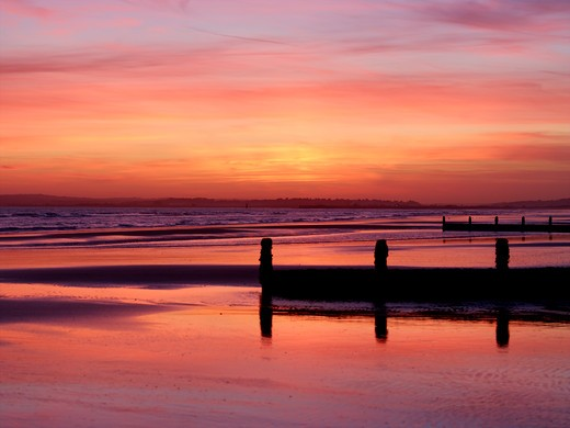 UK, East Sussex, Camber Sands at sunset : Stock Photo