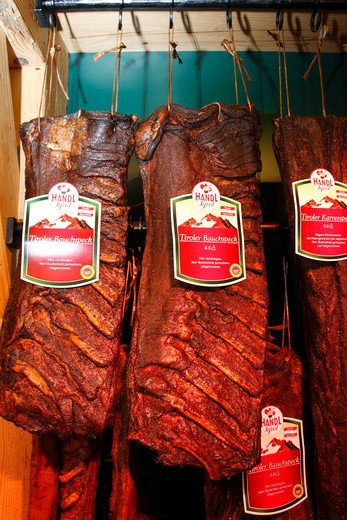 Austria, Tyrol, St. Anton Am Arlberg, Traditional Tyrol style smoked ribs hanging in butchers : Stock Photo