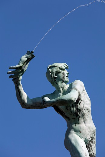 Detail of the Brabo Fountain showing Silvius Brabo throwing giant Druon`s hand. : Stock Photo