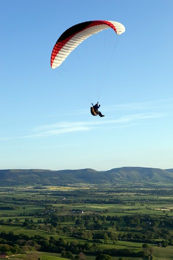 Parasailing over the North York Moors National Park. : Stock Photo