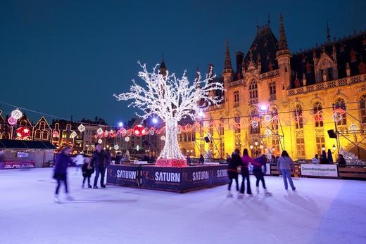 Belgium - West Vlaanderen (Flanders) - Bruges - Christmas Ice skating rink in the Market Place : Stock Photo