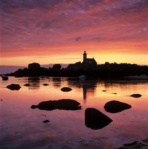 France - Brittany/Finistere - Near Brignogan Plage - Sunrise over Pointe de Pontusval Lighthouse. : Stock Photo