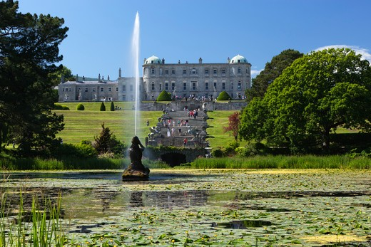 Ireland - County Wicklow - Near Bray - Powerscourt Estate - Powerscourt House. View over Triton Lake and fountain to House and Italian Gardens : Stock Photo