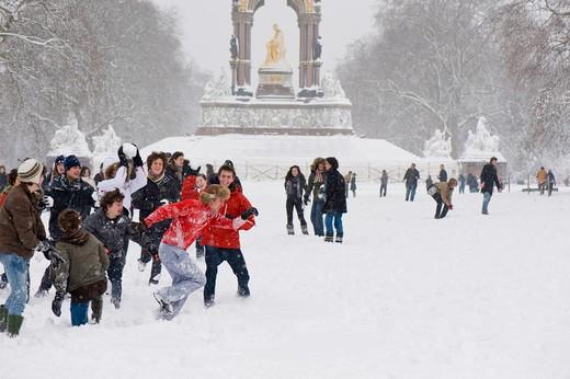 School Children Are Having Snowball Fight In Kensington Gardens Covered In February Snow : Stock Photo