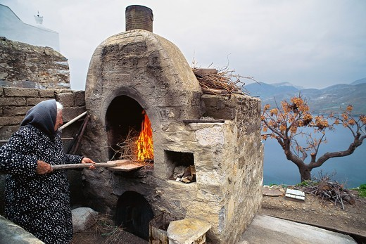 Stock Photo: 196-2349 Greece, Astipalea, Woman at stone oven