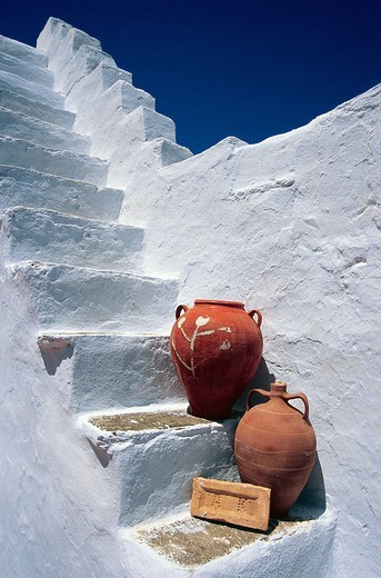 Stock Photo: 196-2375 Greece, Cyclades, Tinos Island, Two jugs on old white steps
