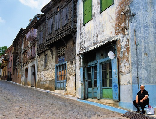 Stock Photo: 196-2417 Greece, Aegean Sea, Lesvos, Woman sitting in old town street