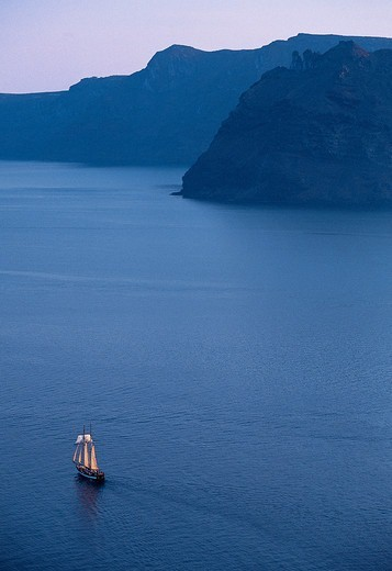 Greece, Cyclades, Santorini Island, Ship on calm sea at dusk : Stock Photo