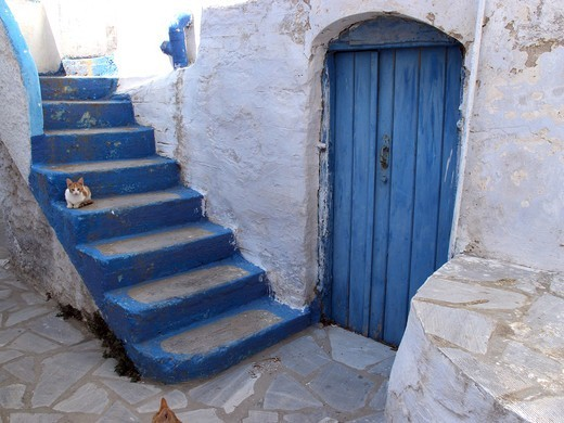 Greece, Cyclades, Tinos island, Blue door and steps : Stock Photo