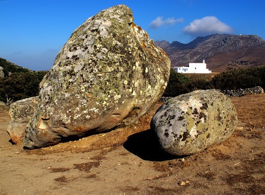 Greece, Cyclades, Tinos island, Large rocks, church in background : Stock Photo