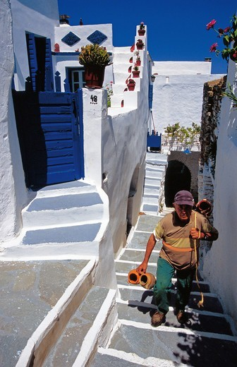 Stock Photo: 196-2587 Greece, Cyclades, Tinos island, Smardakito village, Local man walking up steps towards house