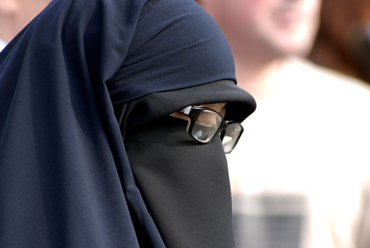 London, Muslim Woman With Glasses In Regent's Park : Stock Photo