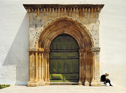 The Eastern Algarve, (The Sotavento) Conceicao Church Door, Near Tavira With Old Lady Doing Crochet Work : Stock Photo