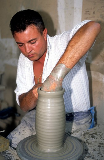Deruta A Man Making A Piece Of Pottery In A Ceramics Factory : Stock Photo