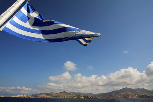 Greece Cyclades Ios Island Greek Flag Billowing In The Wind On The Back Of A Ferry Boat : Stock Photo