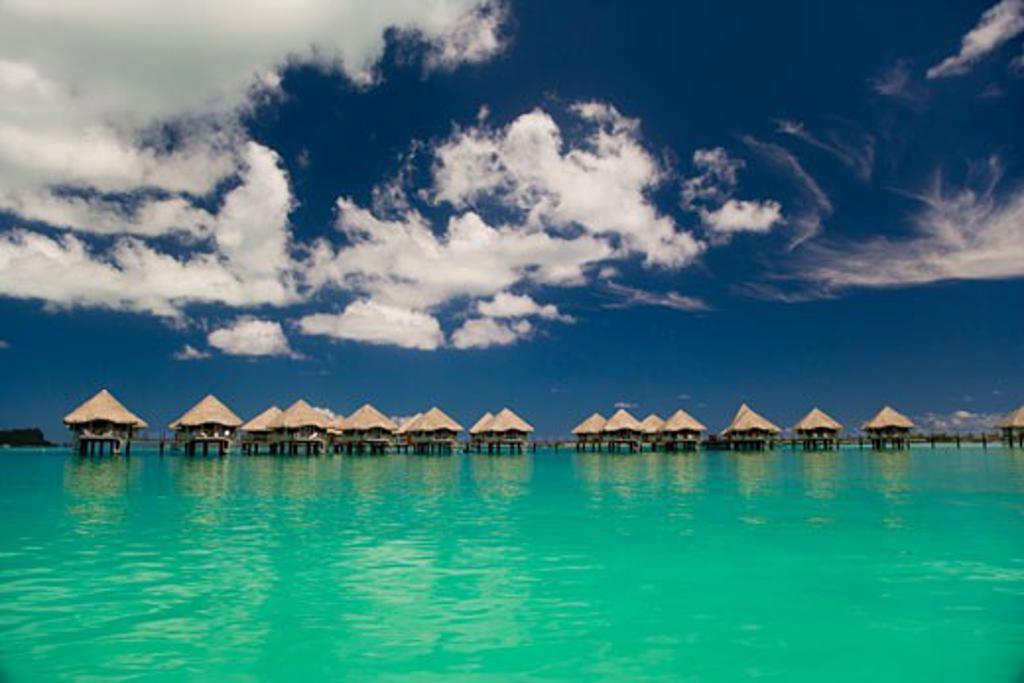 Reflection Of Resort Beach Huts In The Sea Bora Bora