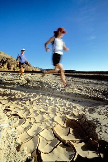 Stock Photo: 1989-1164 Blurred motion of young couple running in Death Valley  California  USA