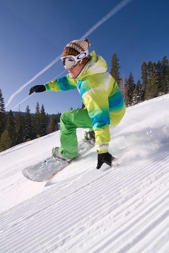 Stock Photo: 1989-1313 A man snowboarding on a freshly groomed slope on a sunny day at Northstar near Lake Tahoe in California
