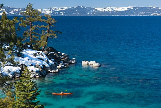A man sea kayaking on Lake Tahoe near Incline Village in Nevada : Stock Photo