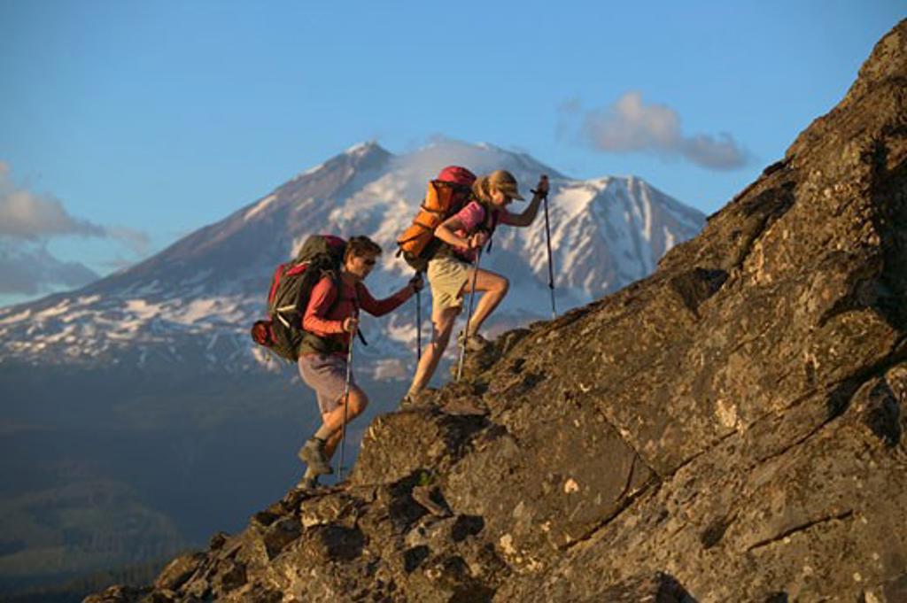 Stock Photo: 1989-1534 A couple hiking up a mountain ridge near Mount Adams