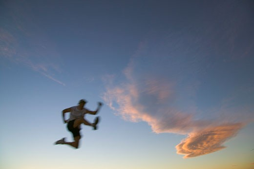 Stock Photo: 1989-1671 A man running and jumping near Truckee CA