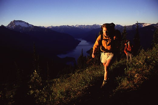 A couple backpacking high up in the North Cascades mountains : Stock Photo