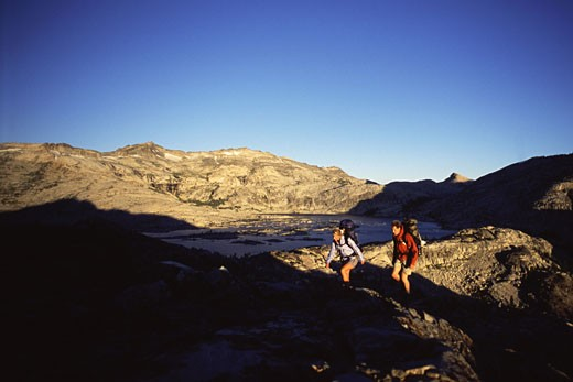 Stock Photo: 1989-1936 A couple backpacking in Desolation Wilderness near Lake Tahoe CA