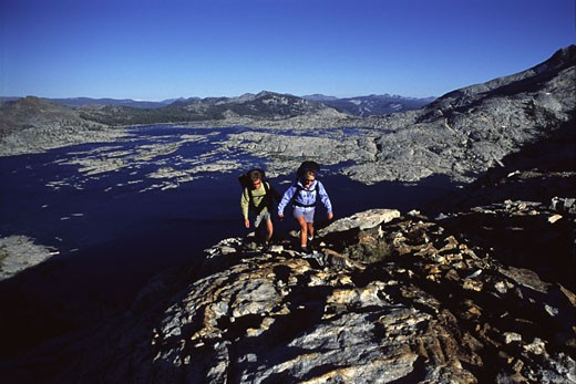 Stock Photo: 1989-1943 A couple backpacking in Desolation Wilderness near Lake Tahoe CA