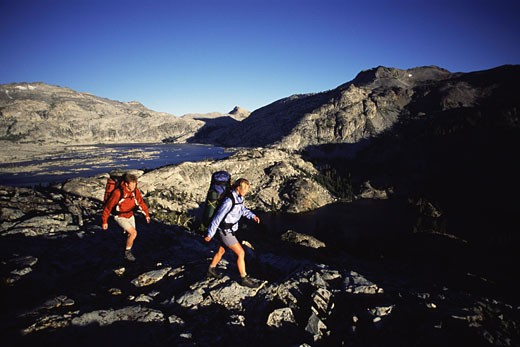 Stock Photo: 1989-1945 A couple backpacking in Desolation Wilderness near Lake Tahoe CA
