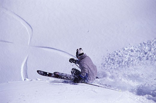 Stock Photo: 1989-2223 A man skiing powder snow at Squaw Valley CA