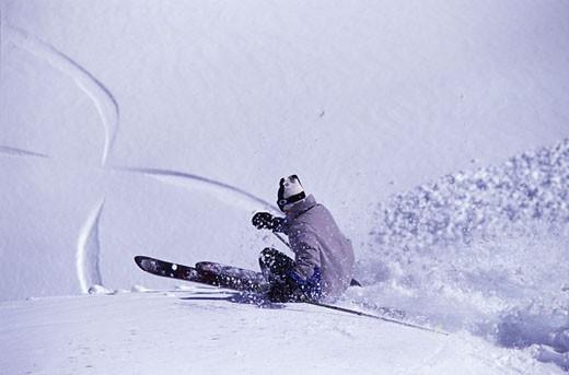A man skiing powder snow at Squaw Valley CA : Stock Photo
