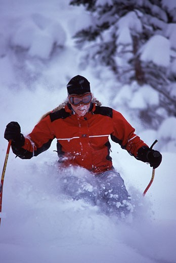 Stock Photo: 1989-2243 A woman skiing powder at Alpine Meadows CA