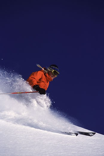 A woman skiing powder at Alpine Meadows CA : Stock Photo