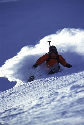 Stock Photo: 1989-2253 A woman skiing powder at Alpine Meadows CA