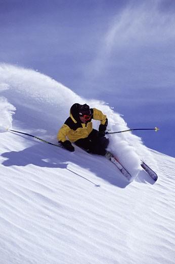 Stock Photo: 1989-2614 A man skiing powder snow at Snowbird UT