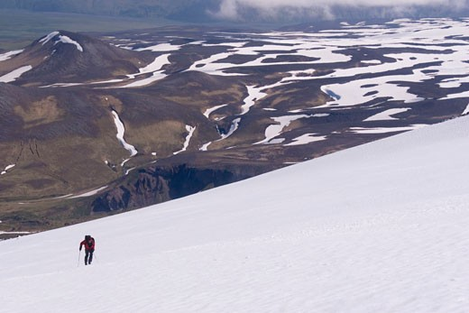 Stock Photo: 1989-2862 A skier climbing Mount Vsevidov in the Aleutian islands Alaska with the tundra below