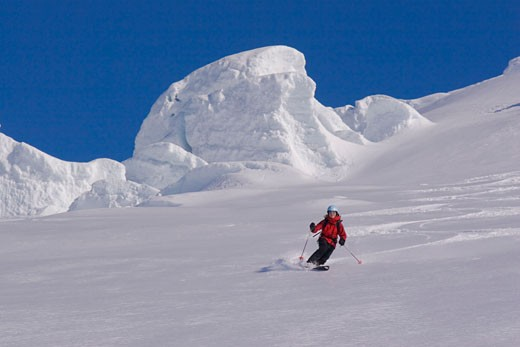 Stock Photo: 1989-2875 A woman skiing on a glacier on Mount Vsesevidov in the Aleutian Islands in Alaska