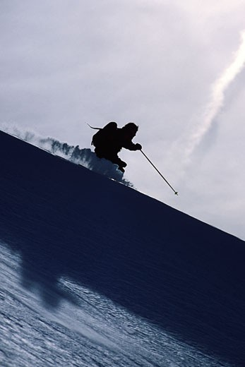 A man skiing powder snow in the Wasatch mountains of Utah : Stock Photo
