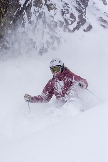 A woman skiing deep powder snow in a storm Alpine Meadows in Lake Tahoe California : Stock Photo