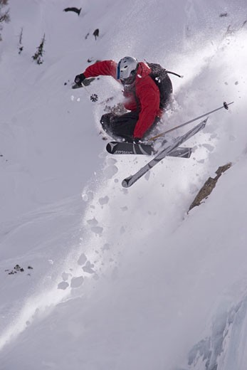 Stock Photo: 1989-3410 A man skiing off a cliff in deep powder snow ion Donner Summit California