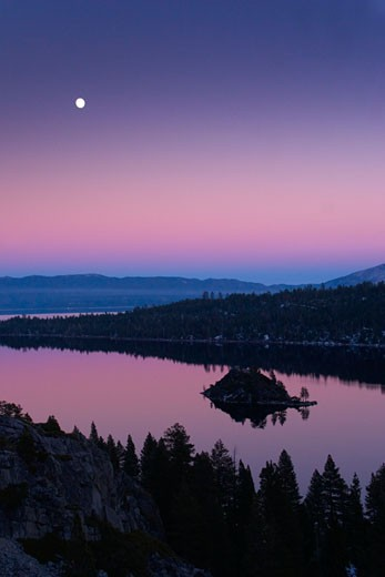 Stock Photo: 1989-3937 The full moon rising over Emerald Bay at sunset with alpenglow at Lake Tahoe California