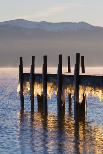 Stock Photo: 1989-4071 Icicles beneath a dock on Lake Tahoe in California at sunrise