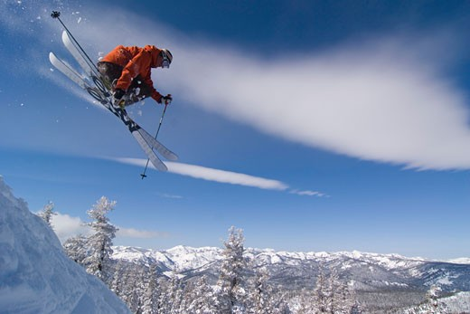 A man jumping on skis at Northstar ski area near Lake Tahoe in California : Stock Photo