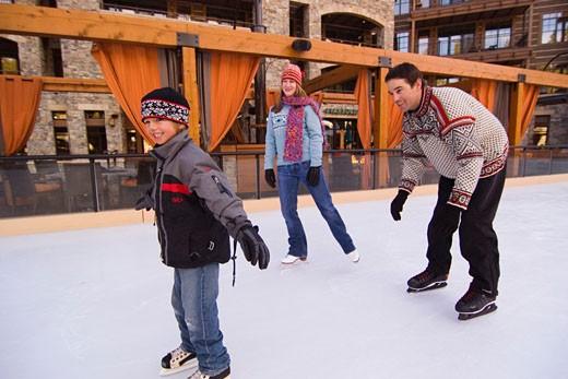 Stock Photo: 1989-4197 A family ice skating at Northstar ski resort near Lake Tahoe in California