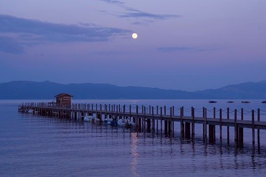 Stock Photo: 1989-4290 The full moon rising over Lake Tahoe California and a pier