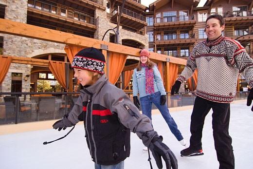 Stock Photo: 1989-4330 A family ice skating at Northstar ski resort near Lake Tahoe in California