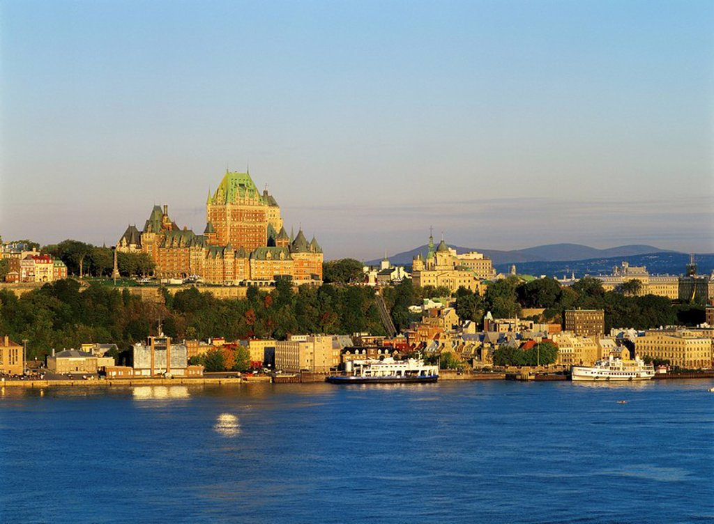 Historic Chateau Frontenac and Quebec City on the banks of the Saint Lawrence River, Quebec, Canada : Stock Photo