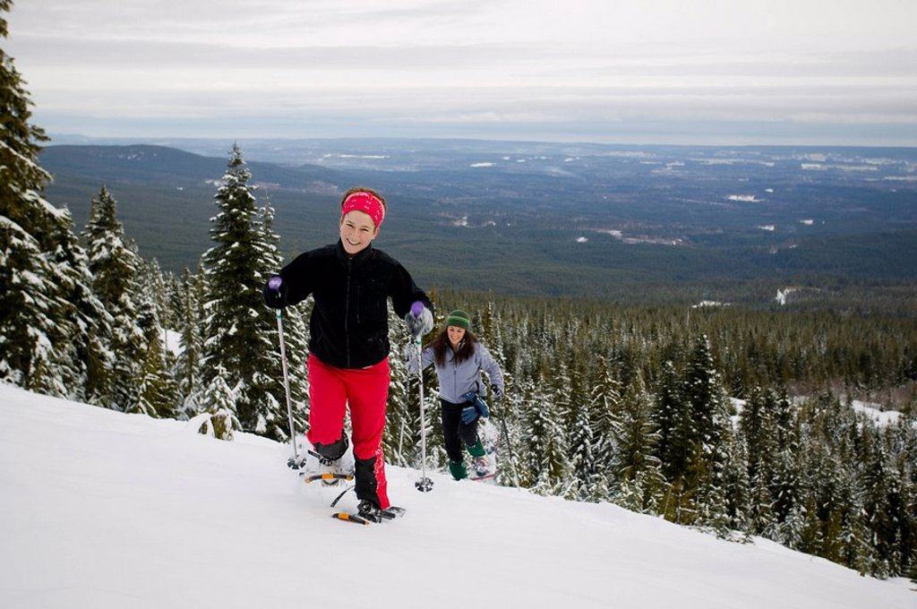 Snowshoeing at Forbidden Plateau, Comox Valley in background  Courtenay, Vancouver Island, British Columbia, Canada : Stock Photo